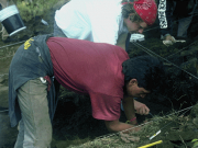 Two researchers work on an excavation