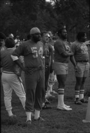 Smithsonian Institution flag football team stands on the sidelines during a game, 1980.