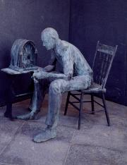 Statue by George Segal of a citizen listening to one of President Roosevelt's fireside chats.