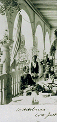 Black and white photograph of Holmes sitting on a porch