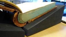 Close-up look at a heavy book with proper support, Smithsonian Institution Archives, 2014.