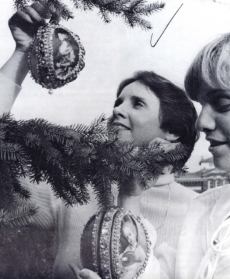 Smithsonian employees hanging Christmas ornaments, 1977