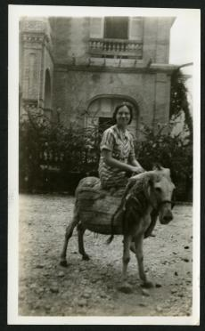 """Ruth, on the sorriest-looking donkey in town. Port-au-Prince, Haiti, August 26, 1935 taken by Richa"