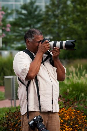 Michael Barnes, Photo Archives Specialist, taking a photo.