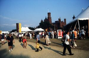 Image shows a close up of tents and people at the Festival of American Folklife, with the with the S