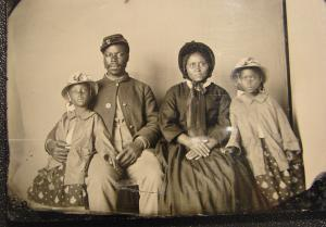 Unidentified African American soldier in Union uniform with wife and two daughters.