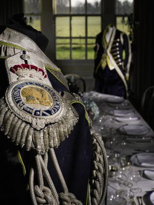 One of the livery uniform tailcoats, with epaulettes with silver-thread royal motto and coat of arms