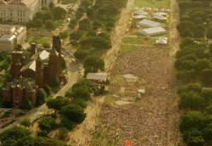 An aerial photograph of the National Mall on August 10, 1996. The Mall is packed with people for the
