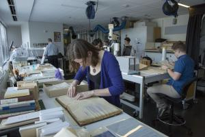 Color photo of staff at work in the Archives Preservation Lab.