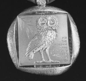 Square B&W image of a owl motif pendant.