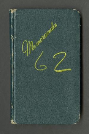 "Cover of green notebook with ""Memoranda"" and ""62"" in yellow ink."