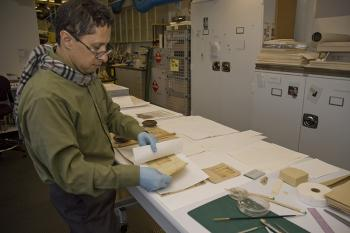 Color photo of a Volunteer at work in the Archives Processing Lab