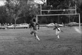 Tommy Brown carries Smithsonian flag football team to victory, 1980.