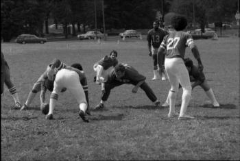 Smithsonian Institution flag football team lined up for a field goal, 1980.