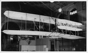 The original Wright Flyer hanging from the ceiling in the Arts and Industries Building, 1948.