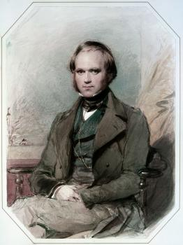 Colored image of a man sitting with his legs crossed. He is wearing a formal jacket and fest. He has