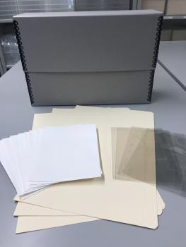 Mylar slips, a manuscript box, folders and other materials used to preserve family photographs and d