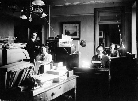 Helen Munroe, Chairman of the Smithsonian Red Cross auxiliary at her desk in the Publications Room.