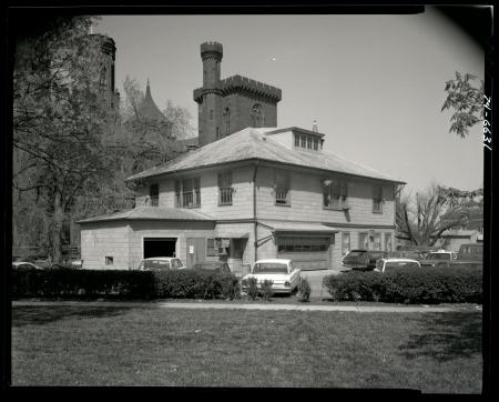 Exterior view of South Shed, looking northeast with Smithsonian Institution Building, or Castle, in