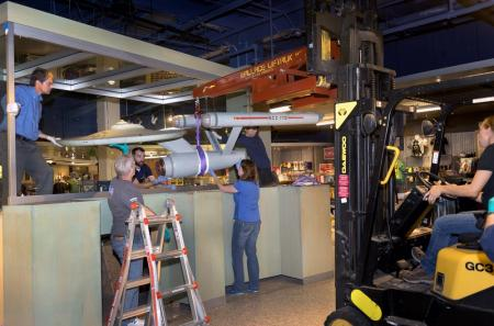 The Star Trek starship Enterprise Studio Model being removed from the lower level of the National Ai