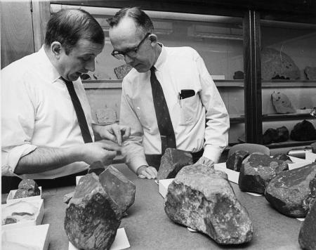 Mineralogists Eugene Jarosewich, Chemist, and Roy S. Clarke, Jr., Associate Curator, examine samples