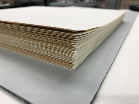 Book pages with board in between.