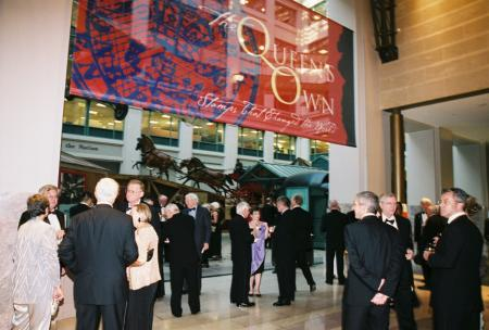 Guests in formal attire in the interior exhibition space of the National Postal Museum.