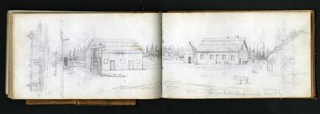 Color photograph of a handheld field notebook opened, and displaying a sketch of a rural landscape.