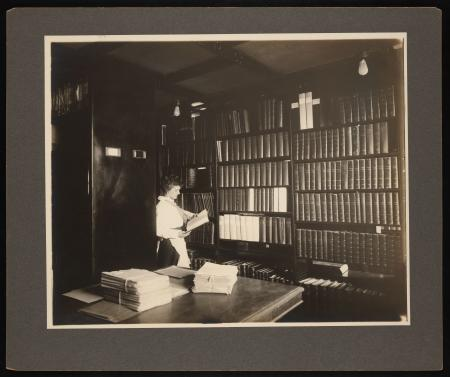 N.G. Morrison in section of new steel bookstacks in library at east end of Great Hall in the Smithso