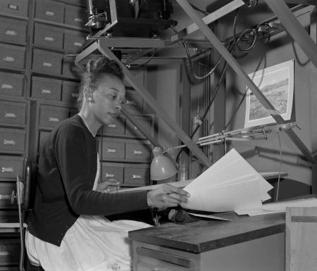Scanning technique demonstrated by Mattie Woodford, Powell Group film scanner, taken April 1961. Nat