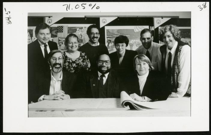A group of people, both standing and seated, pose for a photograph.