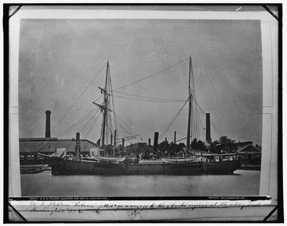 Black and white photograph of a docked ship.