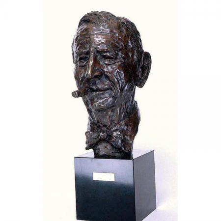 Sculpted bronze bust of Rube Goldberg wearing a bowtie with a cigar in his mouth, gifted to the NMAH