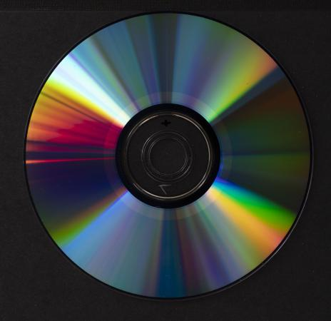The center portion of the reverse side of a disc has a ring of color that is lighter from the rest o