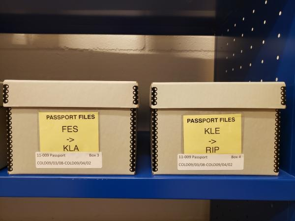 Two boxes labeled passport files.