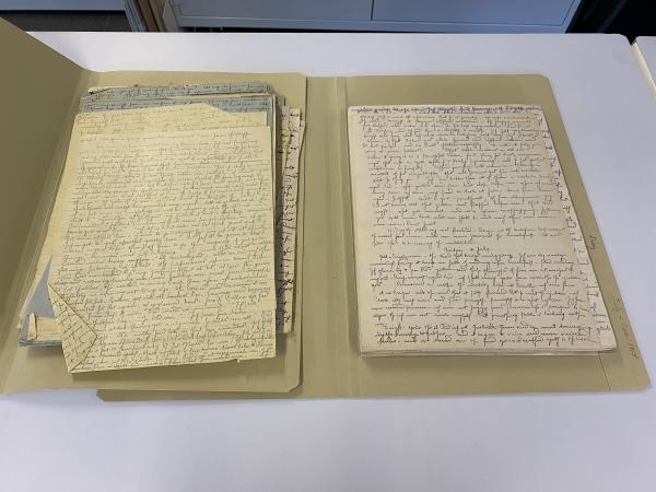 Side-by-side of damaged papers, with folds and tears, and recently treated papers in good conditions