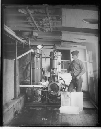 Unidentified Man on Deck of Ship with Hatching Equiment