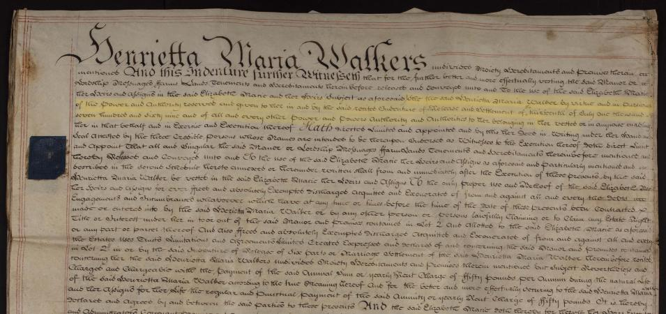 The top half of a yellowed parchment sheet is shown, covered densely with dark brown ink. A passage