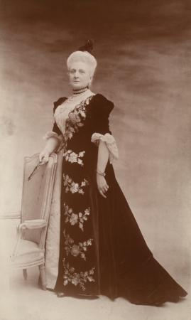 Photograph of a woman wearing a long gone.