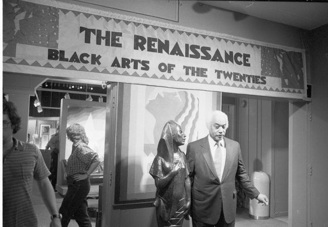"""Mercer Ellington, son of Duke Ellington, stands at the entrance of the exhibit """"The Renaissance: Bla"""