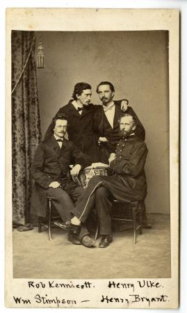 Four young men, members of the Megatherium Club, two seated in the foreground and two standing behin
