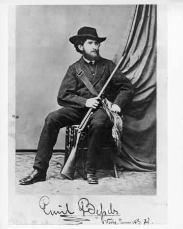 Card of Bessels in a uniform and holding a gun.