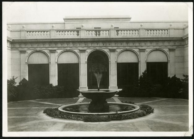 View of the courtyard at the center of the Freer Gallery. A working fountain is in view.