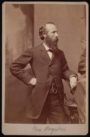 Portrait of Henry Van Ness Boynton standing in a suit.