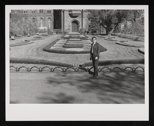View of a man standing in front of the Victorian Garden.