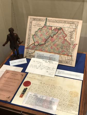 Image of documents and a map on display. The map is of Virginia and West Virginia.