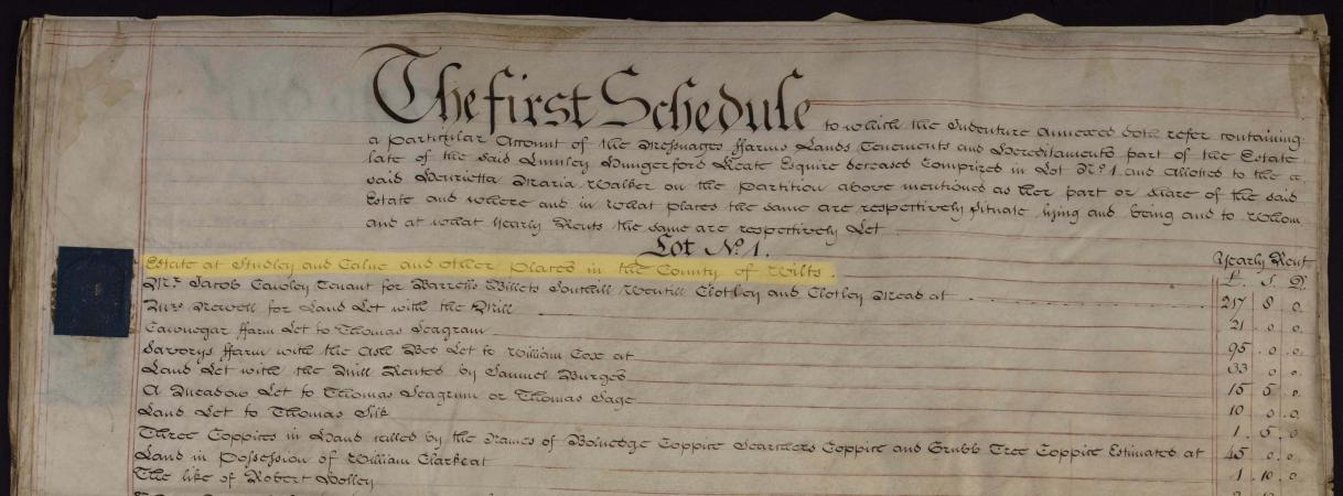 A close-up view of a parchment sheet, covered closely with black ink writing. A passage is highlight