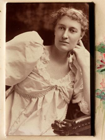 Eliza R. Scidmore posing in white gown, 1895.