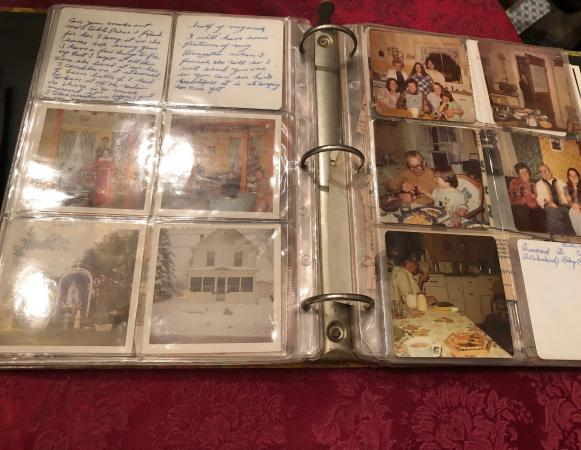 A family photograph album in three-ring binder format, with photographs housed in plastic sleeves. C