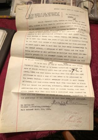 A typed legal court document dated March 1935. The pages have been paper-clipped together and show m